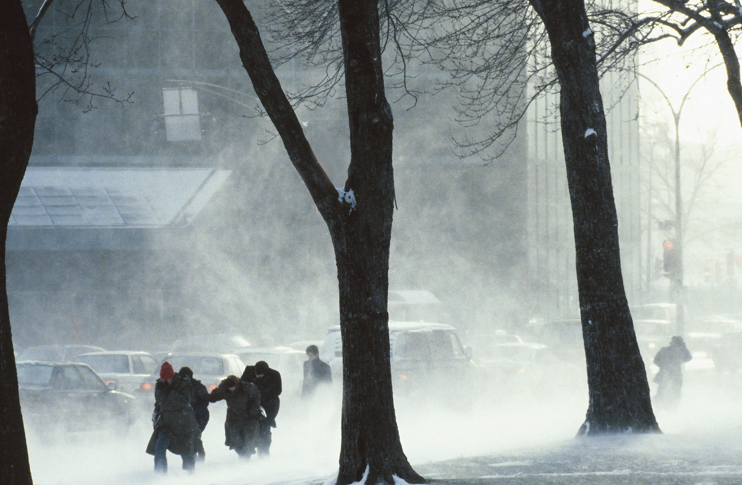 "Photo provided by Environment Canada (photo.com) "" People huddle against the cold wind""."